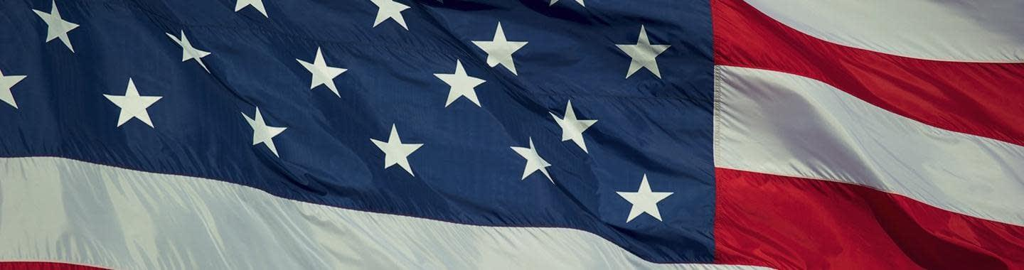 american-flag-1440×380-darkened
